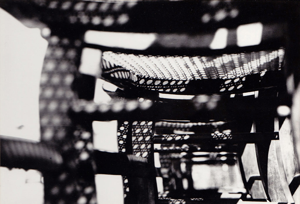 Tennessee · black and white photo of the bottom of wicker chairs